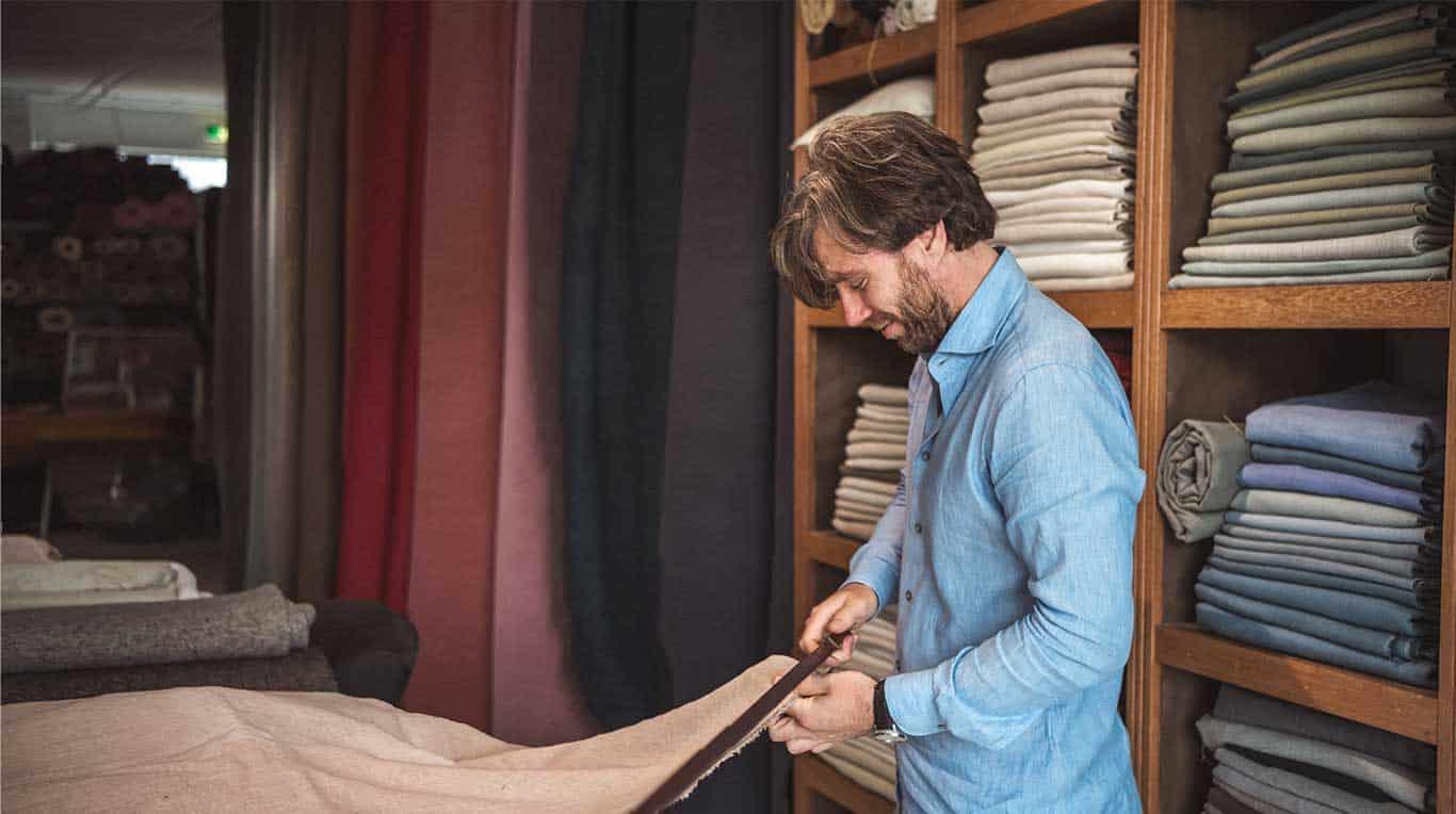 Evert Groot measuring up fabrics